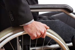 Man in wheelchair who suffered paralysis due to negligence will need the help of skilled Seattle Malpractice Lawyers.